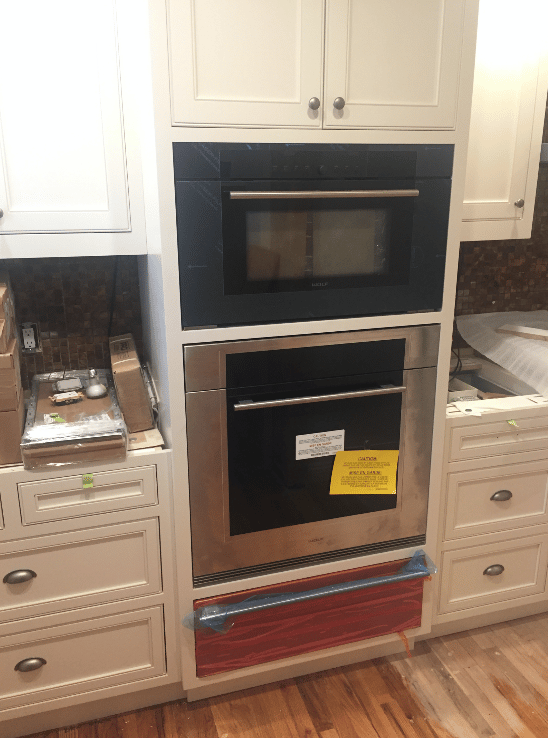 image on page for  / perceived to contain Appliance Oven Bathroom Indoors Furniture Entertainment Center